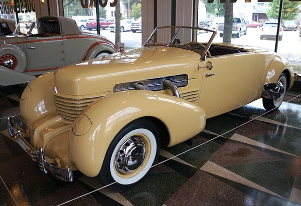 A 1937 Cord Supercharged Convertible is displayed in the showroom on the ground level of the Cord building which now serves as the A-C-D Museum.