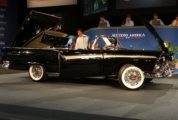 When a 1957 Ford Fairlane Skyliner Retractable came up on the stage they lowered the top into its secret compartment in the trunk.
