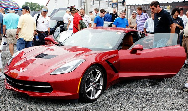 A crowd gathers around the 2014 Corvette Stingray.