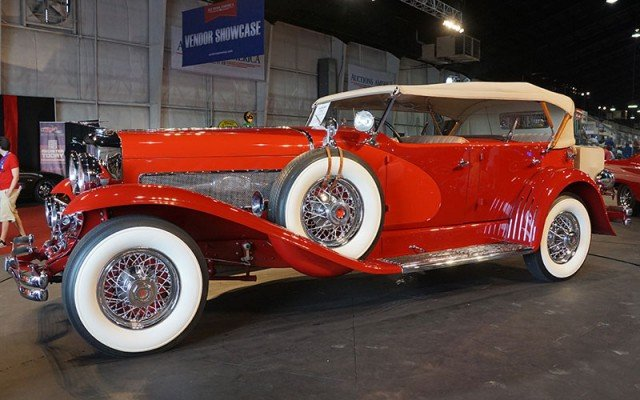 1935 Duesenberg Model SJ Dual Cowl Phaeton sold during the Auctions America Auction at Auburn Festival