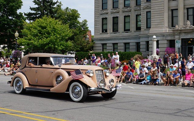 Auburn passes DeKalb County Courthouse at the Auburn Cord Duesenberg Parade
