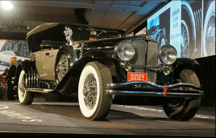 Beautiful vintage motorcars as this 1930 Duesenberg Model J Dual Cowl Phaeton crossed the block at the RM/Sotheby Auction here at the 2015 Amelia Island Concours. The hammer price was $1,050,000. (Photo by Bob Boberg of eClassicAutos.com)