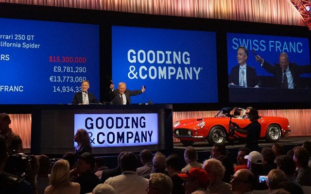 SOLD! The scoreboard behind the auctioneer shows this 1961 Ferrari 250 GT SWB California Spider brought a final price of $15,300,000. (Photos by Bob Boberg of eClassicAutos.com)