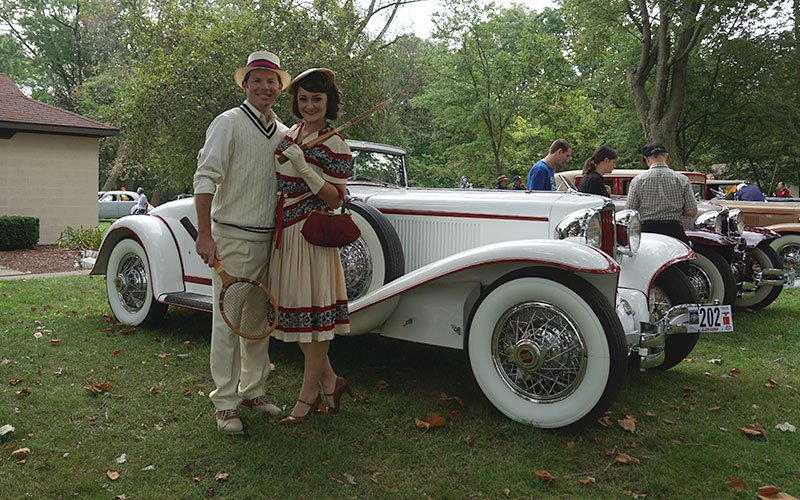 Period custumes in Eckhart Park at the Auburn Cord Duesenberg Festival