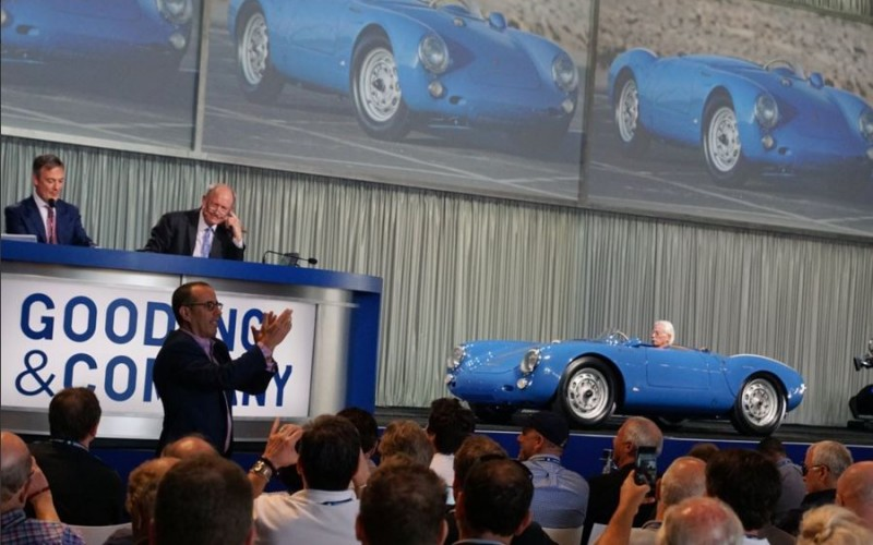 Seinfeld claps in the foreground as his 1955 Porsche 550 Spyder sells for $4.85 million