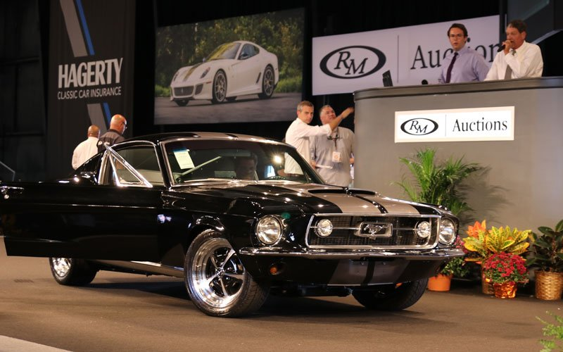1967 Mustang Fastback Resto Mod sells at the Fall Auburn Auction